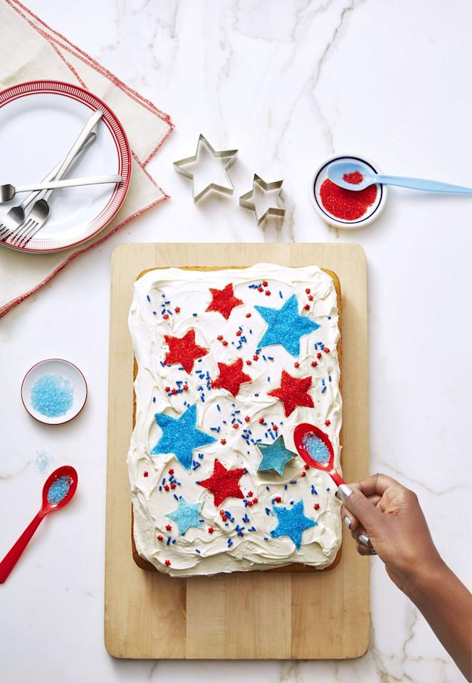 "<p>Give a simple cake some Fourth of July flair: Place star-shaped cookie cutters on the iced cake and sprinkle on blue and red sanding sugar. Double the recipe to make a sheet cake for the whole family!</p><p><a href=""https://www.goodhousekeeping.com/food-recipes/a4836/basic-vanilla-cake-69/"" target=""_blank""></a><em><a href=""https://www.goodhousekeeping.com/food-recipes/a4836/basic-vanilla-cake-69/"" target=""_blank"">Get the recipe for Basic Vanilla Cake »</a></em></p>"