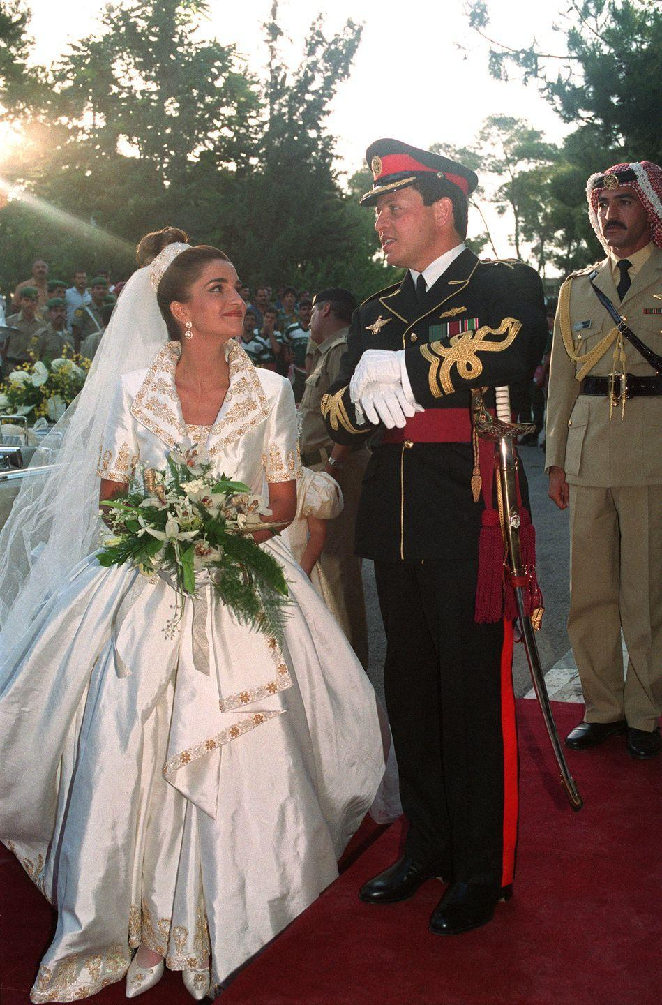 "<p>Queen Rania of Jordan married Prince Abdullah on June 10, 1993 in Amman. She wore an intricate gown, created by British designer Bruce Oldfield, with a voluminous skirt and gold-detailed trim. </p><p><strong>See more:</strong> <a href=""https://www.townandcountrymag.com/society/tradition/a15839272/princess-eugenie-engaged/"" rel=""nofollow noopener"" target=""_blank"" data-ylk=""slk:Princess Eugenie is Enagaged!"" class=""link rapid-noclick-resp"">Princess Eugenie is Enagaged!</a><br></p>"