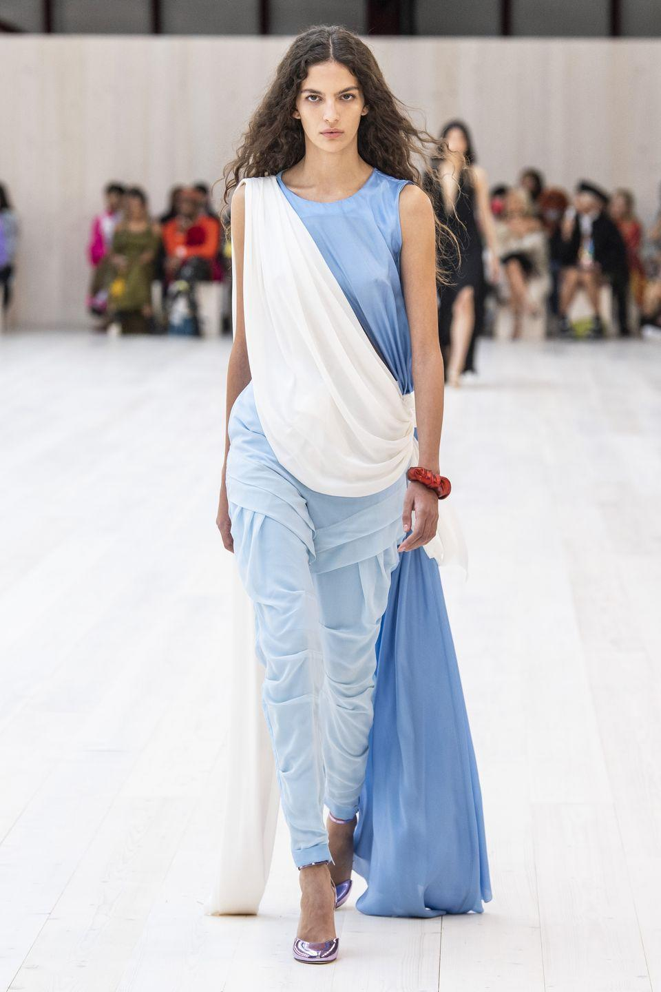 """<p>Jonathan Anderson staged Loewe's spring/summer 2022 show at the equestrian arena of La Garde Républicaine, a historic location in the centre of Paris, where models emerged through the floor, from a hidden underground space. The collection – which was the first that had been presented through a catwalk show since the pandemic began – was described by the house as """"a renaissance"""".</p><p>""""The runway returns with an unabashed outburst of experimentation—where provocation, sensuality and movement mark a definitive point of departure.""""</p>"""