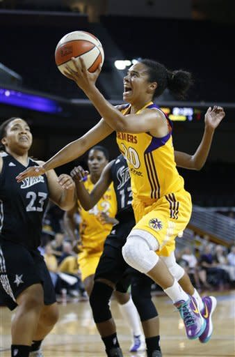 Los Angeles Sparks' Kristi Toliver goes up for a shot as San Antonio Silver Stars' Danielle Adams, background left, watches during Game 1 of a WNBA basketball first-round playoff series, in Los Angeles on Thursday, Sept. 27, 2012. (AP Photo/Jae C. Hong)