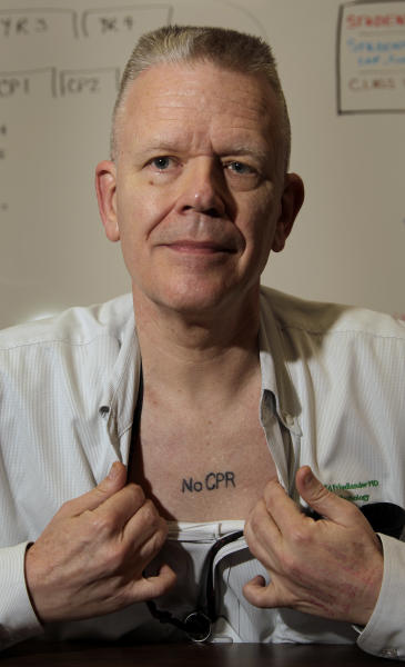 In this photo taken Sept. 29, 2011, Kansas City, Mo. pathologist Dr. Ed Friedlander displays his tattoo with a medical directive to not use CPR. Friedlander is among a growing number of people who are getting tattoos that tell doctors and first responders about their medical concerns, from chronic conditions like diabetes and asthma to allergies and more. (AP Photo/Charlie Riedel)