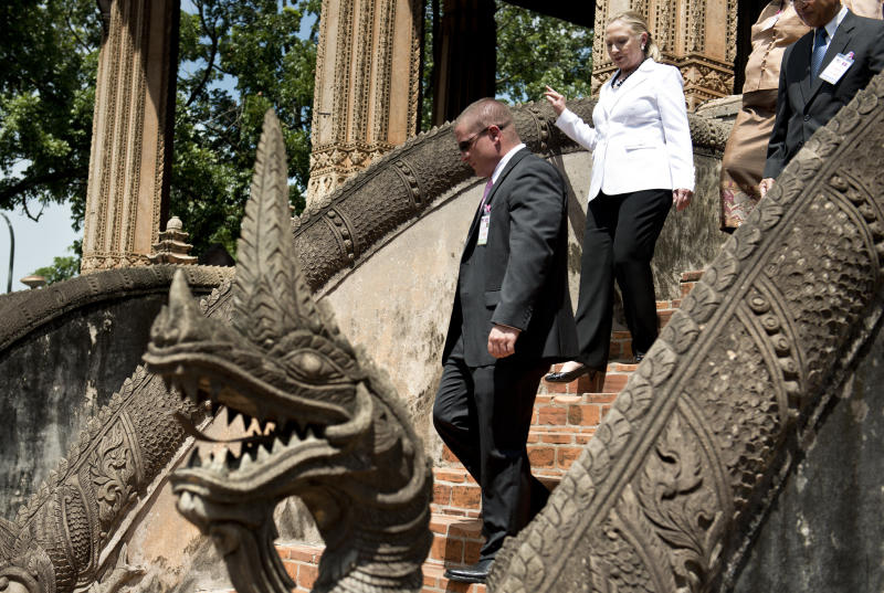 U.S. Secretary of State Hillary Rodham Clinton leaves after her tour at the Ho Phra Keo Temple in Vientiane, Laos, Wednesday, July 11, 2012. (AP Photo/Brendon Smialowski, Pool)