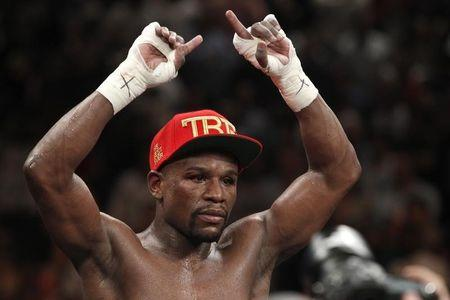Floyd Mayweather Jr. of U.S. celebrates victory over Marcos Maidana of Argentina following WBC/WBA welterweight unification fight at MGM Grand Garden Arena in Las Vegas
