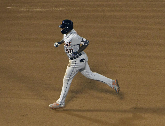 Detroit Tigers' Ronny Rodriguez (60) runs the bases after hitting a two-run home run against the Chicago White Sox during the fourth inning of a baseball game, Wednesday, Sept. 5, 2018, in Chicago. (AP Photo/David Banks)