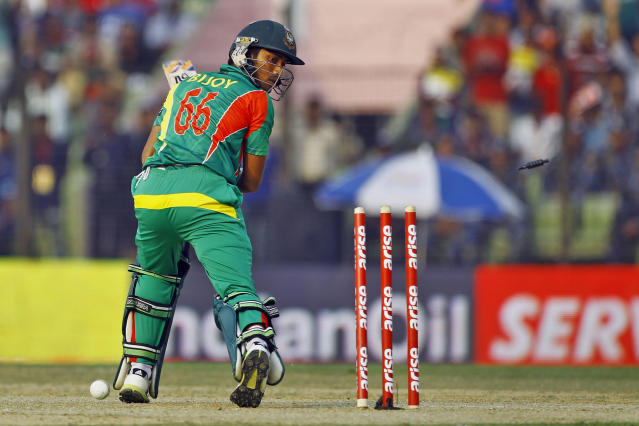Bangladesh's Anamul Haque looks back on his stumps after being bowled out by India's Varun Aaron during the Asia Cup one-day international cricket tournament in Fatullah, near Dhaka, Bangladesh, Wednesday, Feb. 26, 2014. (AP Photo/A.M. Ahad)