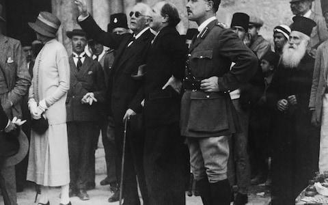 Lord Arthur Balfour (1848 - 1930) points out a feature of the Church of the Holy Sepulchre to Governor Sir Ronald Storrs during a visit to Jerusalem, 9th April 1925 - Credit:  Topical Press Agency/Hulton Archive