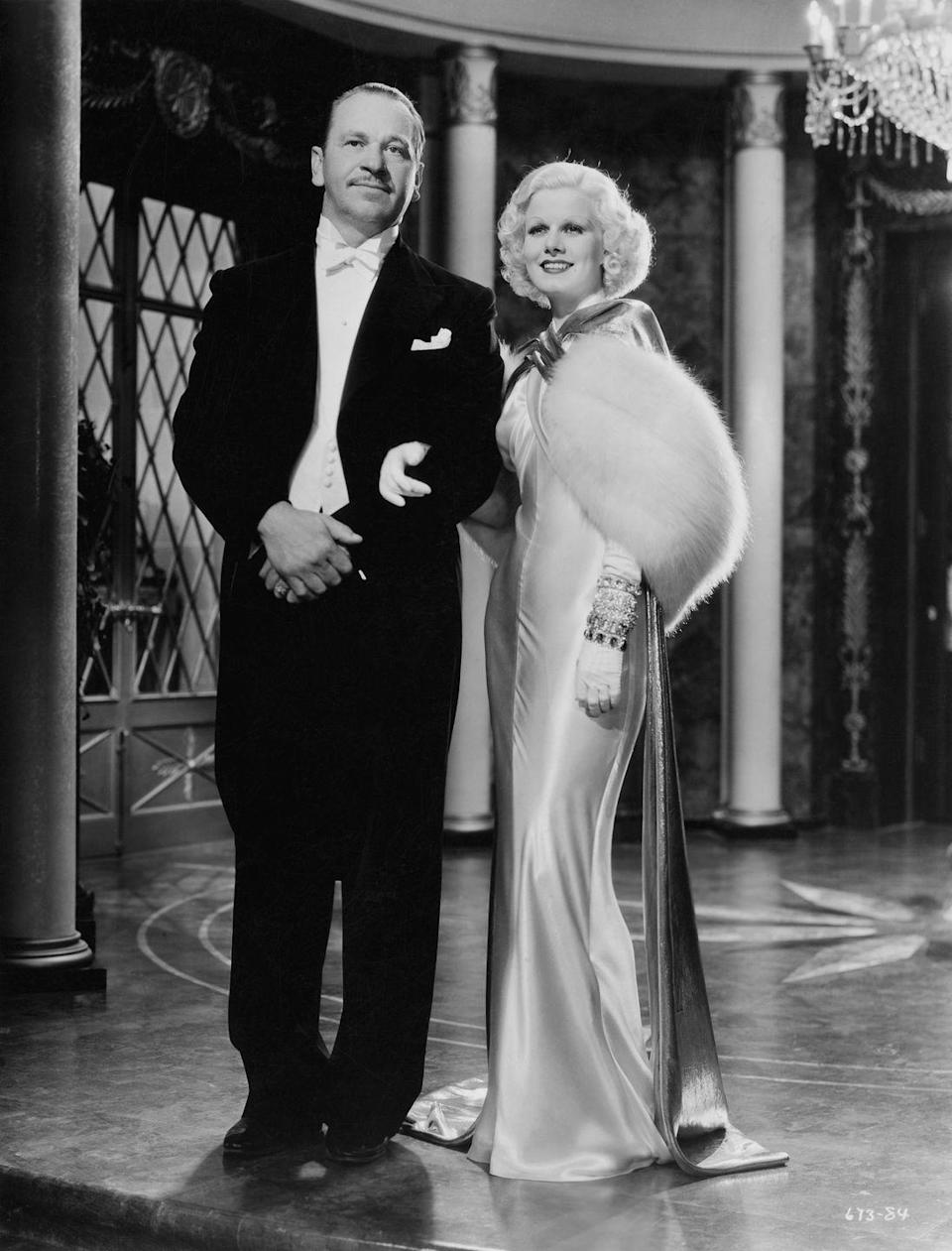 <p>Hollywood's original blonde bombshell, Jean Harlow, was playing Kitty Packard in <em>Dinner at Eight </em>when she wore this caped silk slipdress and white fur stole, but it could have just as easily been worn by the starlet herself.  </p>