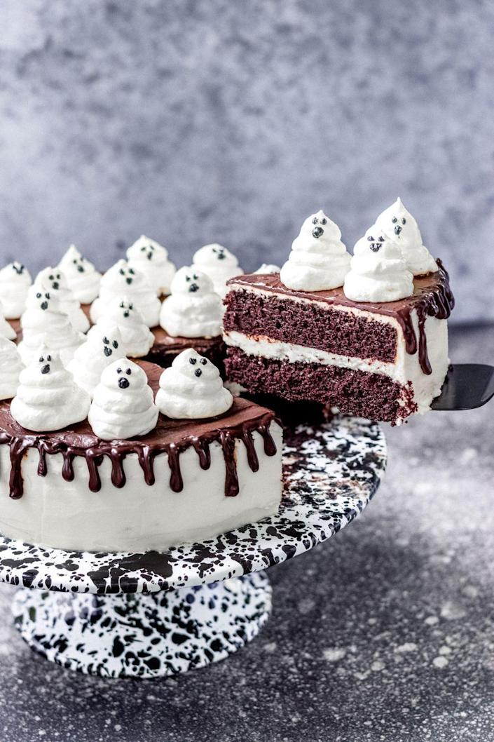 """<p>Use melted chocolate or dye a little buttercream black to make spooky ghost faces!</p><p>Get the recipe from <a href=""""https://www.delish.com/cooking/recipe-ideas/a33850502/ghost-cake-recipe/"""" rel=""""nofollow noopener"""" target=""""_blank"""" data-ylk=""""slk:Delish"""" class=""""link rapid-noclick-resp"""">Delish</a>.</p>"""