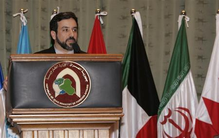 Iran's deputy foreign minister for legal and international affairs Abbas Araghchi speaks during a news conference in Baghdad