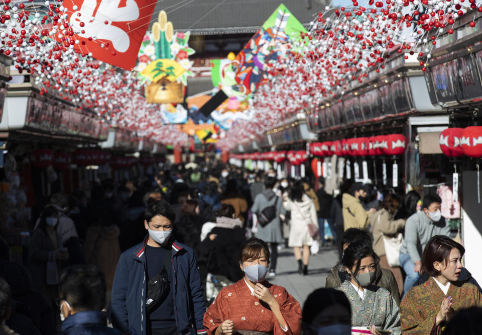 People wearing face masks to help curb the spread of the coronavirus visit Sensoji temple on New Year's Eve in Tokyo Thursday, Dec. 31, 2020. (AP Photo/Hiro Komae)