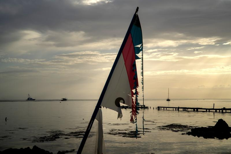 A worn-out surf sail hangs from a pole standing on the beach at a private harbor where several boats are being moved away for protection ahead of the arrival of Tropical Storm Dorian in Boqueron, Puerto Rico, Aug. 27, 2019. (Photo: Ramon Espinosa/AP)