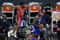 New Orleans Pelicans guard Sindarius Thornwell (15) defends against Los Angeles Clippers guard Paul George (13) during the third quarter of an NBA basketball game Wednesday, Jan. 13, 2021, in Los Angeles. (AP Photo/Ashley Landis)