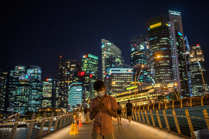 A man walks along the Merlion Park, a major tourist attraction in Singapore. (PHOTO: LightRocket via Getty Images)