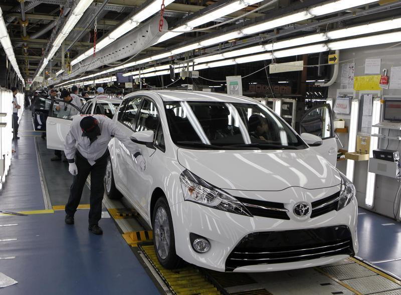 Employees work at an assembly line at the Toyota manufacturing plant in Sakarya