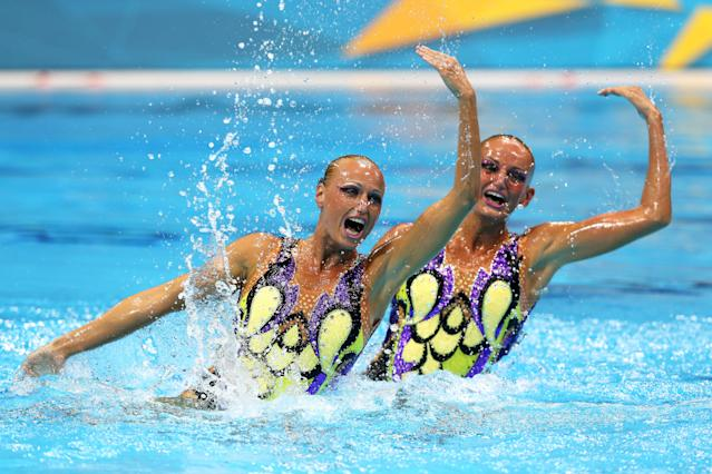 Nadine Brandl and Livia Lang of Austria compete in the Women's Duets Synchronised Swimming Technical Routine on Day 9 of the London 2012 Olympic Games at the Aquatics Centre on August 5, 2012 in London, England. (Photo by Clive Rose/Getty Images)