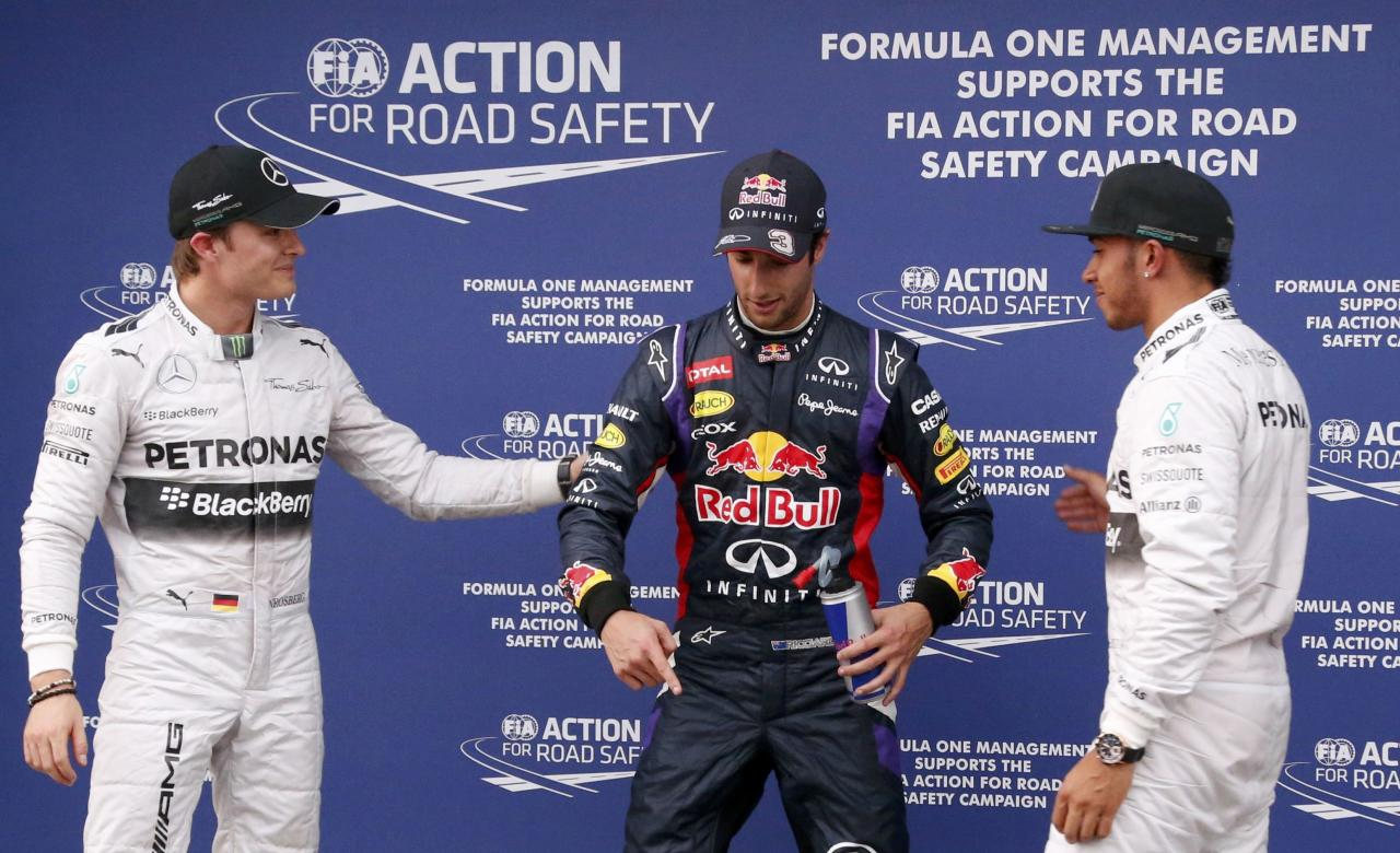 Mercedes Formula One driver Hamilton celebrates taking pole position with Red Bull Formula One driver Ricciardo and Mercedes Formula One driver Rosberg after the qualifying session for the Australian F1 Grand Prix in Melbourne