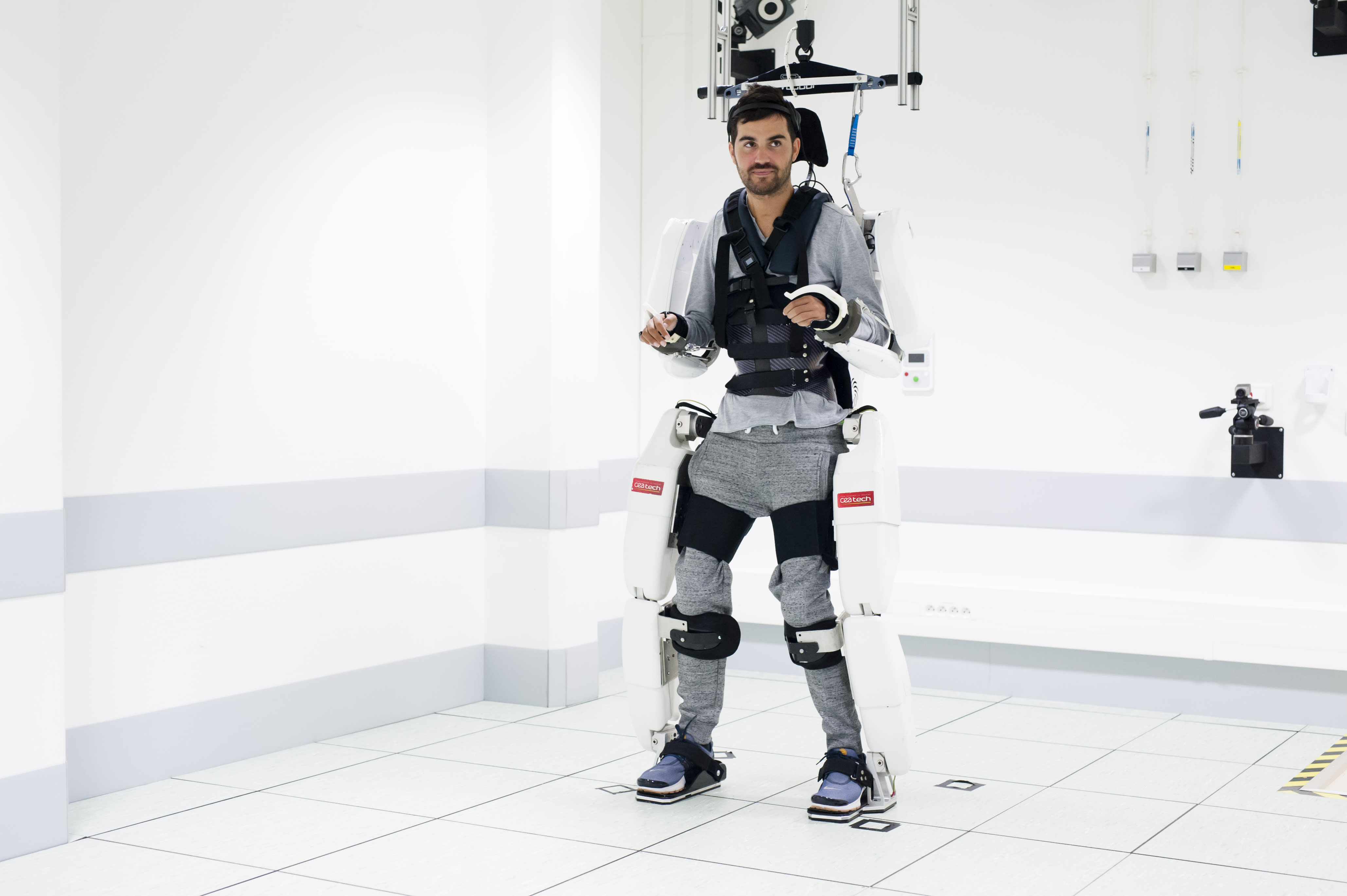 Thibault walked with the help of the exoskeleton (Picture: Fonds de dotation Clinatec)