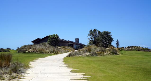 """<div class=""""caption""""> A path that leads to Tara Iti's clubhouse </div>"""