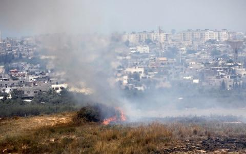 <span>A fire burns in scrubland in Israel near the Gaza Strip, in an area where Palestinians have been causing blazes by flying kites and balloons loaded with flammable material</span> <span>Credit: AMIR COHEN/REUTERS </span>