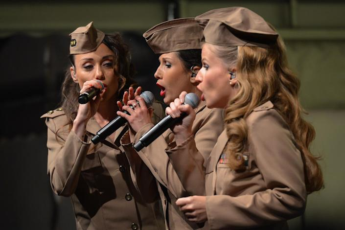 <p>The French trio Girly Swing, dressed in U.S. Army 1944 uniforms, perform – – during D-Day Festival Normandy 2017. (Photo: Artur Widak/NurPhoto via Getty Images) </p>