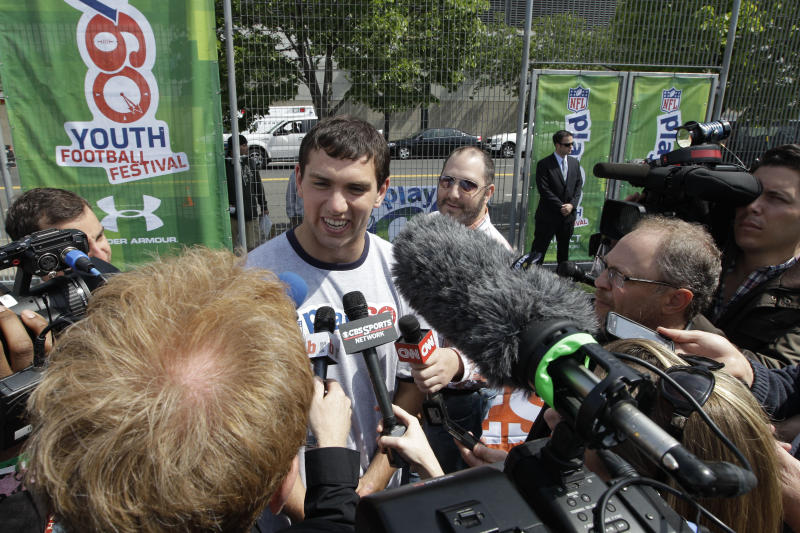 Andrew Luck is surrounded by reporters during the NFL Play 60 Youth Football Festival, Wednesday, April 25, 2012, in New York. (AP Photo/Mary Altaffer)