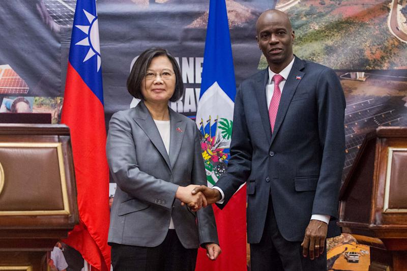 Taiwan's President Tsai Ing-wen and Haiti's President Jovenel Moise shake hands during a state visit in Port-au-Prince on July 13, 2019. - Taiwan President Tsai Ing-wen's choice of Port-au-Prince as the first stop in her Caribbean tour is highly symbolic of the diplomatic power struggle being played out in the region. Last year, the neighboring Dominican Republic dropped Taipei and threw in its diplomatic lot with Beijing, leaving Haiti as one of only 17 countries still officially recognizing Taiwan as a country. (Photo by Pierre Michel JEAN / AFP) (Photo credit should read PIERRE MICHEL JEAN/AFP/Getty Images)
