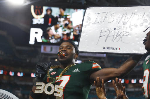 Miami cornerback Al Blades Jr. (7) wears the Turnover Chain after intercepting a pass during the second half of the team's NCAA college football game against Louisville, Saturday, Nov. 9, 2019, in Miami Gardens, Fla. Miami defeated Louisville 52-27. (AP Photo/Wilfredo Lee)
