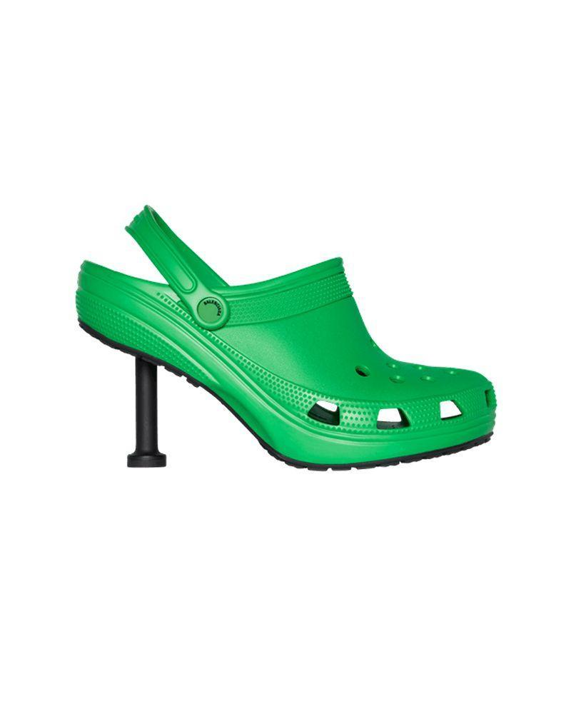 """<p>Behold, the stiletto croc. A chance to see the world's most functional shoe take on a new impracticality. For Balenciaga's Spring 2022 collection, the luxury fashion house has once again teamed up with Crocs, producing both the croc stiletto and also croc boots.</p><p><a class=""""link rapid-noclick-resp"""" href=""""https://go.redirectingat.com?id=127X1599956&url=https%3A%2F%2Fwww.crocs.co.uk%2F&sref=https%3A%2F%2Fwww.elle.com%2Fuk%2Ffashion%2Ftrends%2Fg36656071%2Fcroc-collaborations%2F"""" rel=""""nofollow noopener"""" target=""""_blank"""" data-ylk=""""slk:SHOP CROCS"""">SHOP CROCS</a></p>"""