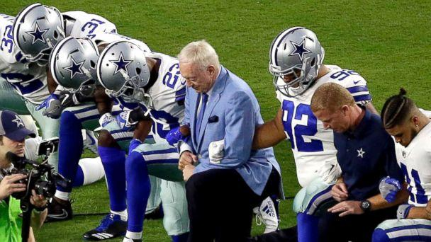 PHOTO: The Dallas Cowboys, led by owner Jerry Jones, center, take a knee prior to the national anthem prior to an NFL football game against the Arizona Cardinals, Sept. 25, 2017, in Glendale, Ariz. (Matt York/AP)