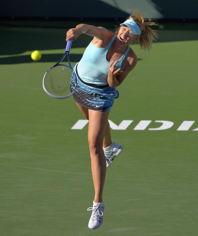 Maria Sharapova, of Russia, serves to Camila Giorgi, of Italy, during a third round match at the BNP Paribas Open tennis tournament, Monday, March 10, 2014 in Indian Wells, Calif. (AP Photo/Mark J. Terrill)