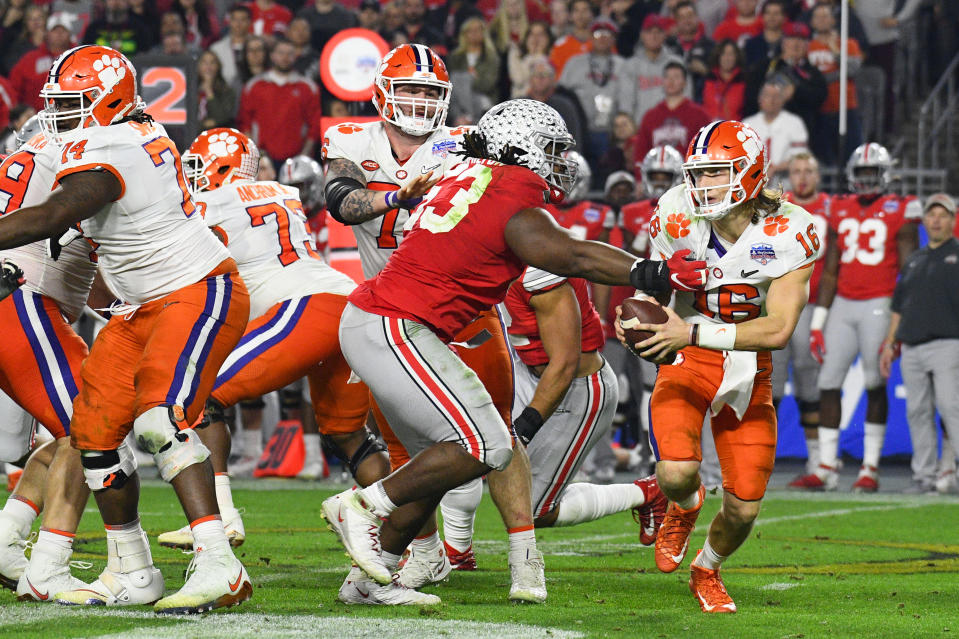Clemson Tigers QB Trevor Lawrence (16) is pressured by Ohio State Buckeyes DT DaVon Hamilton (53) during the 2019 Fiesta Bowl. (Brian Rothmuller/Icon Sportswire via Getty Images)