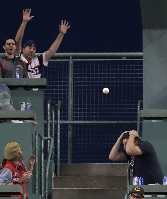 A fan ducks out of the way of a solo home run by Chicago White Sox's Jose Abreu during the sixth inning of a baseball game against the Boston Red Sox at Fenway Park in Boston, Monday, June 24, 2019. (AP Photo/Charles Krupa)