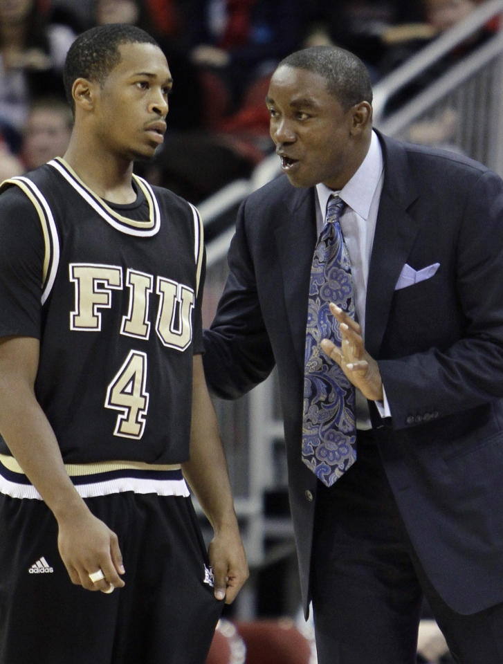 Florida International coach Isiah Thomas talks to guard Phil Gary (4) during a break in the second half of an NCAA college basketball game against Louisville in Louisville, Ky., Wednesday, Dec. 1, 2010.