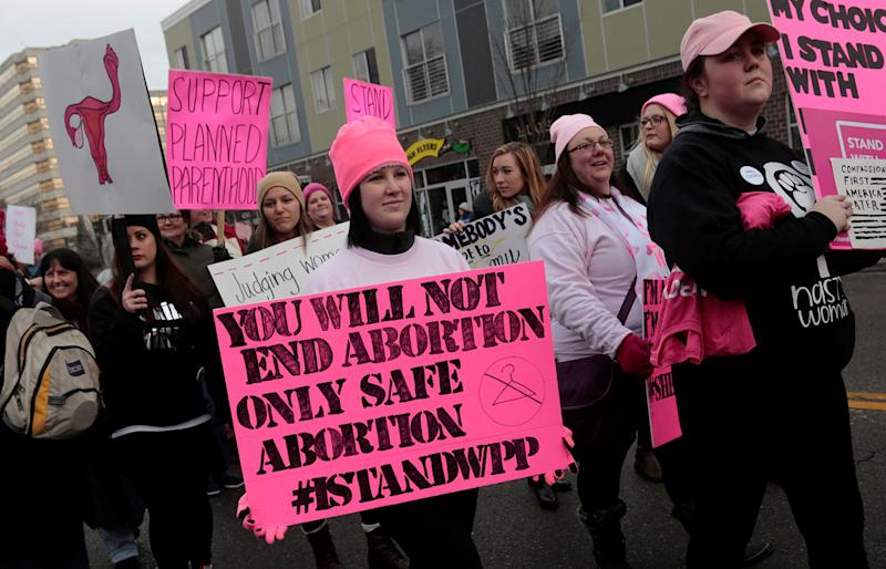 <p>Pro-abortion-rights supporters of Planned Parenthood rally outside a Planned Parenthood clinic in Detroit, Mich., Feb. 11, 2017. (Photo: Rebecca Cook/Reuters) </p>