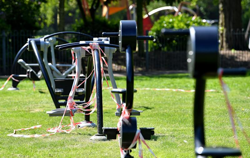 Tape covers outdoor gym equipment to prevent people using it, in Abbey Park in Leicester, central England, on April 25, 2020, during the national lockdown due to the novel coronavirus COVID-19 pandemic. - Boris Johnson's government on Saturday was embroiled in a political row after it emerged his chief advisor attended meetings of the main scientific group advising ministers on the coronavirus pandemic in Britain. Downing Street was forced to deny that Dominic Cummings and another advisor, Ben Warner, were members of the politically independent Scientific Advisory Group for Emergencies (SAGE). (Photo by Paul ELLIS / AFP) (Photo by PAUL ELLIS/AFP via Getty Images)
