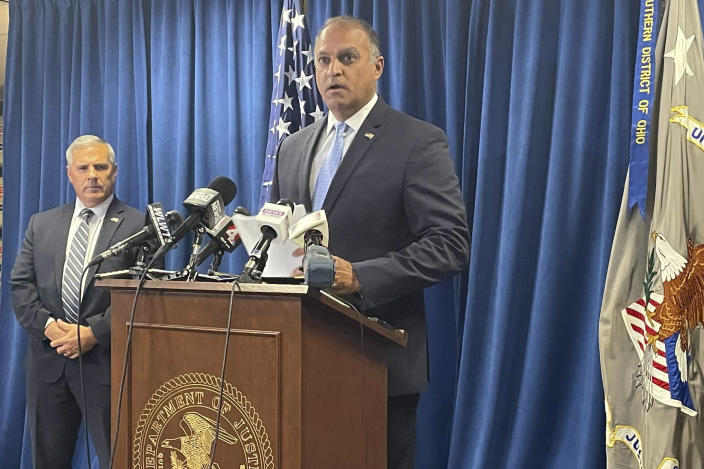 Acting U.S. Attorney Vipal J. Patel, center, accompanied by FBI Special Agent in Charge Chris Hoffman, speaks during a news conference in Cincinnati, Thursday, July 22, 2021. Federal authorities say Akron-based FirstEnergy Corp. would pay a $230 million penalty and fully cooperate as part of an agreement announced Thursday to settle federal charges against the company in a sweeping bribery scheme in Ohio. (AP Photo/Farnoush Amiri)