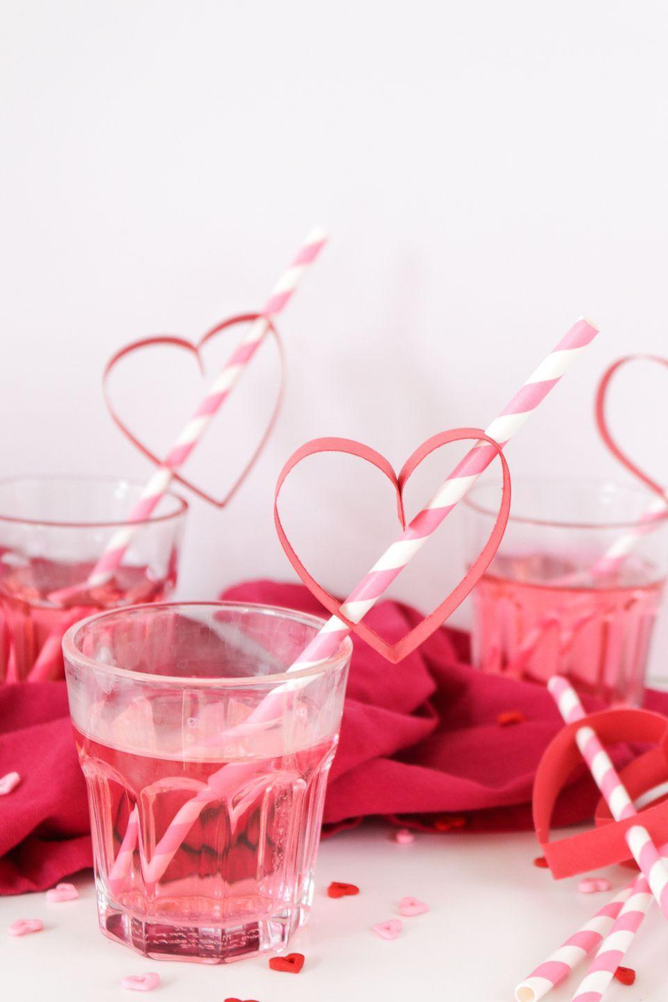 "<p>Punch up your Valentine's Day drinks with this five-minute DIY. Just use a hole punch to thread colorful card stock hearts onto paper straws, and up your serving game big time.</p><p><em><a href=""https://www.clubcrafted.com/diy-heart-straws-for-valentines-day/"" rel=""nofollow noopener"" target=""_blank"" data-ylk=""slk:Get the how-to at Club Crafted»"" class=""link rapid-noclick-resp"">Get the how-to at Club Crafted»</a></em><br></p>"