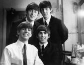 <p>Photographer Val Wilmer took this photo of The Beatles backstage after a concert at the Finsbury Park Astoria in London in 1963. </p>