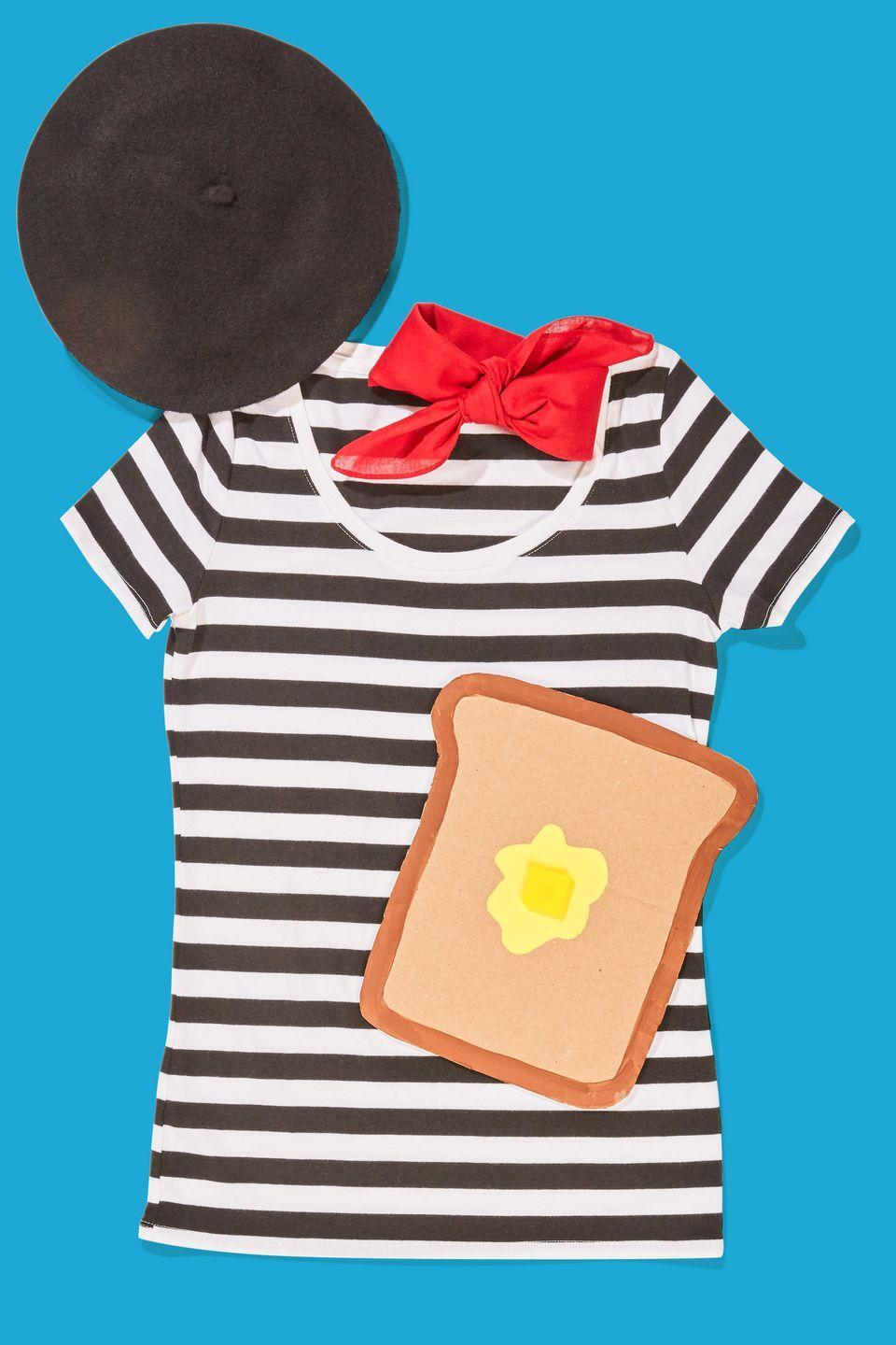 """<p>Round up a <span class=""""redactor-unlink"""">black beret</span>, a striped tee, a red scarf, and a piece of """"toast"""" crafted from cardboard. Punch two holes in the top of the bread and tie string to them to wear around your neck. </p><p><strong><a class=""""link rapid-noclick-resp"""" href=""""https://www.amazon.com/Chapeau-Tribe-Classic-Stretchable-French/dp/B07TW8NCX8?tag=syn-yahoo-20&ascsubtag=%5Bartid%7C10070.g.490%5Bsrc%7Cyahoo-us"""" rel=""""nofollow noopener"""" target=""""_blank"""" data-ylk=""""slk:SHOP BLACK BERETS"""">SHOP BLACK BERETS</a></strong> </p>"""