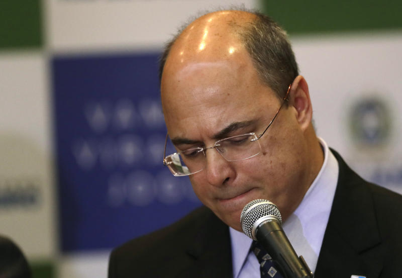 Rio de Janeiro Gov. Wilson Witzel pauses as he gives a news conference concerning the death of an 8-year-old girl in Rio de Janeiro, Brazil, Monday, Sept. 23, 2019. Ágatha Sales Félix died Friday after she was shot in the back while riding in a van in the Complexo do Alemao slum. (AP Photo/Silvia Izquierdo)