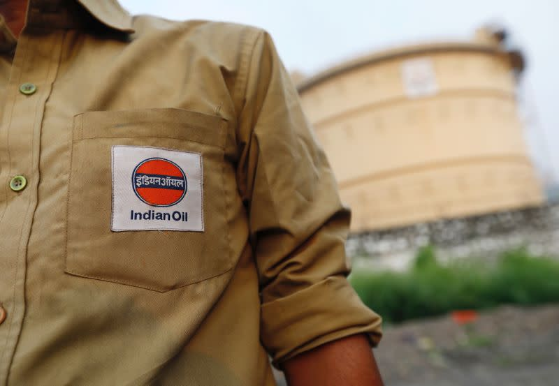 An Indian Oil tanker driver waits outside a fuel depot in Mumbai
