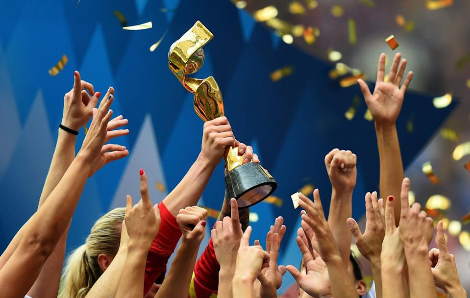 VANCOUVER, BC - JULY 05:  Players of USA celebrate with the trophy after winning the FIFA Women's World Cup 2015 Final between USA and Japan at BC Place Stadium on July 5, 2015 in Vancouver, Canada.  (Photo by Lars Baron - FIFA/FIFA via Getty Images)