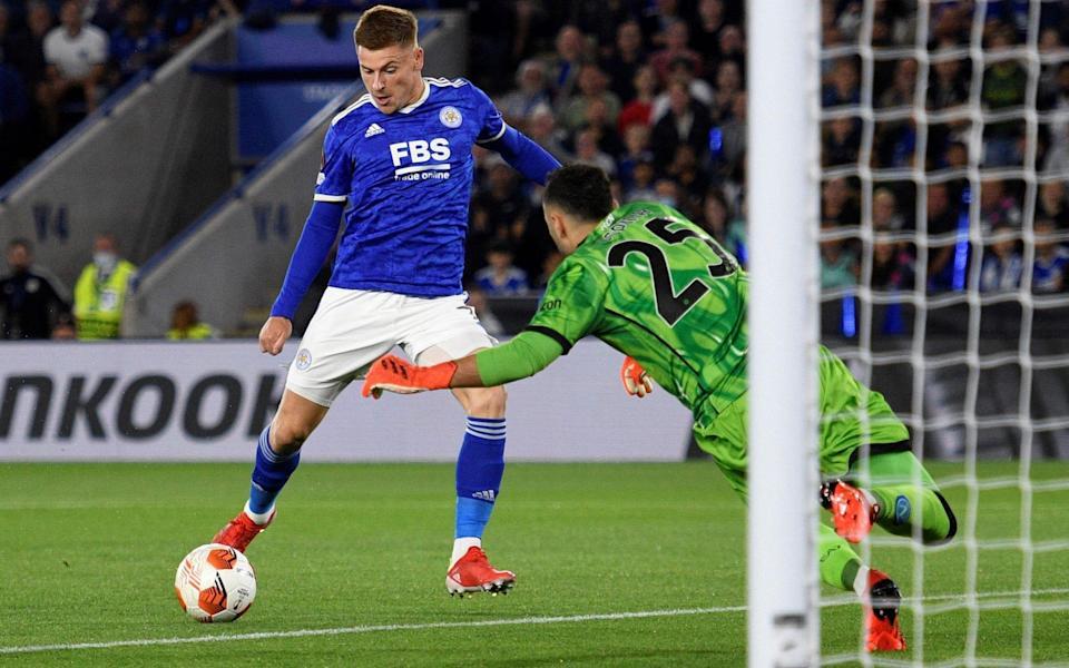 Napoli's Colombian goalkeeper David Ospina (R) dives to save a shot from Leicester City's English midfielder Harvey Barnes - OLI SCARFF/AFP via Getty Images