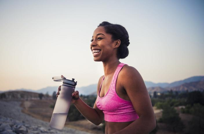 """<span class=""""caption"""">Exercising can increase your need to drink water, but there's no need to overdo it. </span> <span class=""""attribution""""><a class=""""link rapid-noclick-resp"""" href=""""https://www.gettyimages.com/detail/photo/happy-female-runner-holding-water-bottle-royalty-free-image/1012617912?adppopup=true"""" rel=""""nofollow noopener"""" target=""""_blank"""" data-ylk=""""slk:The Great Brigade/Getty Images"""">The Great Brigade/Getty Images</a></span>"""