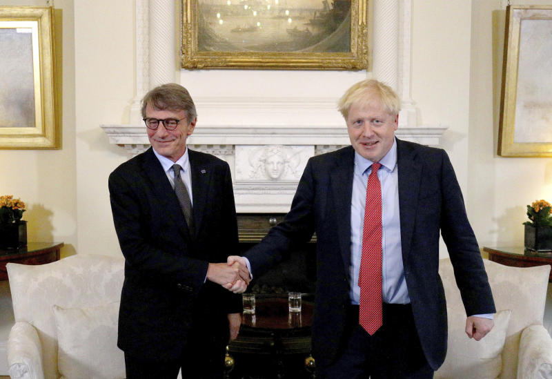 Britain's Prime Minister Boris Johnson, right, shakes hands with the President of the European Parliament David Sassoli, ahead of a private meeting in Downing Street, Tuesday Oct. 8, 2019. (Aaron Chown/Pool via AP)