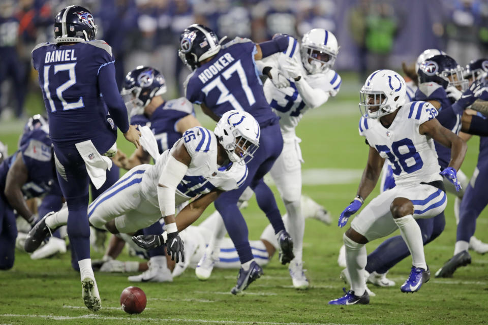 Indianapolis Colts linebacker E.J. Speed (45) blocks a punt by Tennessee Titans punter Trevor Daniel (12) in the second half of an NFL football game Thursday, Nov. 12, 2020, in Nashville, Tenn. Colts cornerback T.J. Carrie (38) recovered the ball and ran it back for a touchdown. (AP Photo/Ben Margot)