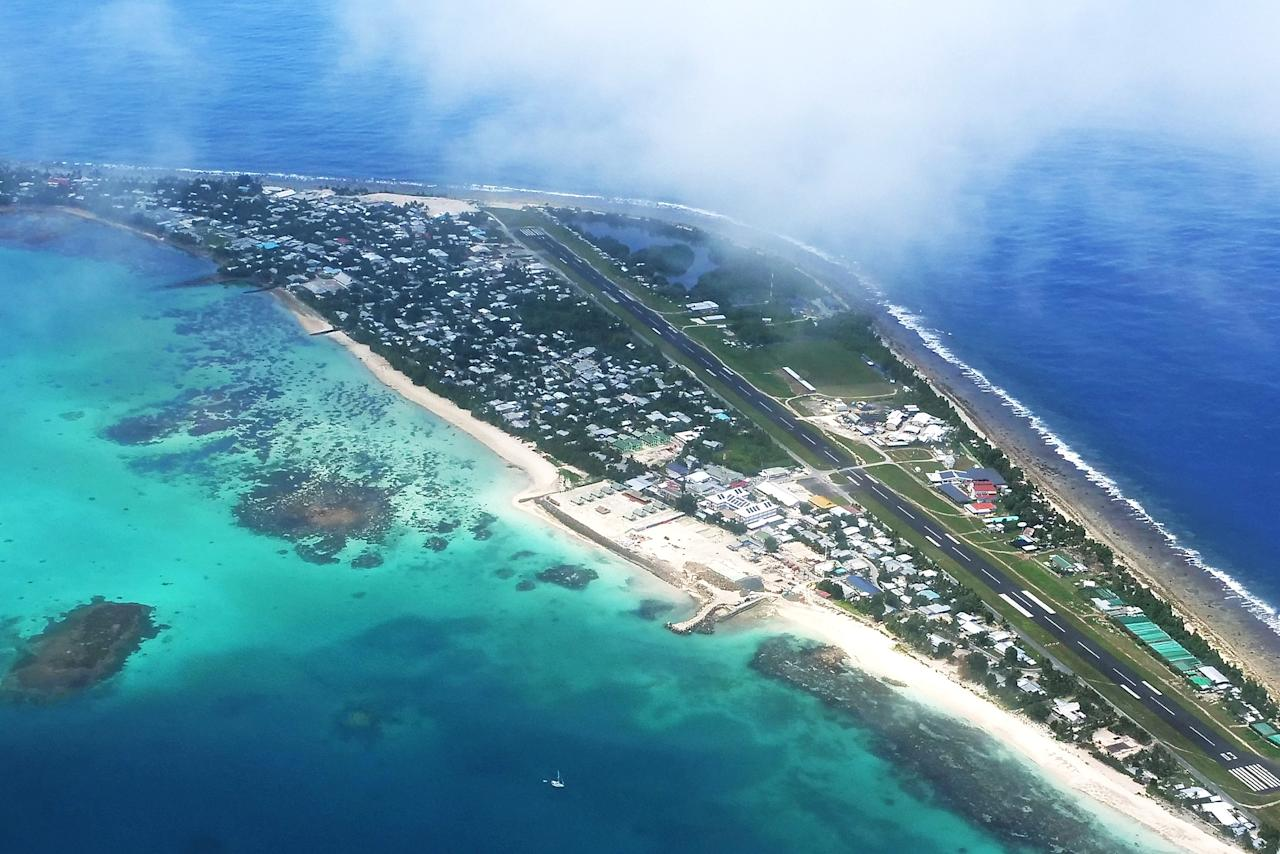 <p>The capital of Funafuti from the air shows an area of successful reclaimation where the Tuvalu Government is now building a convention centre to host the Pacific Island Forum in 2019 on August 15, 2018 in Funafuti, Tuvalu. (Photo by Fiona Goodall/Getty Images for Lumix) </p>