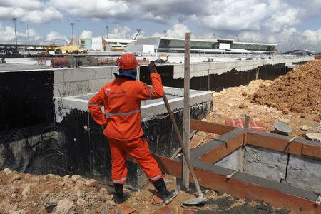A labourer works at Manaus airport in Manaus June 2, 2014. REUTERS/Bruno Kelly