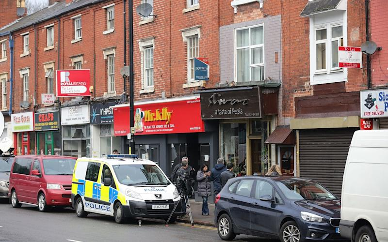 Police outside the flat raided by police above Shiraz Restaurant in Hagley Road - Credit: Christopher Furlong/Getty