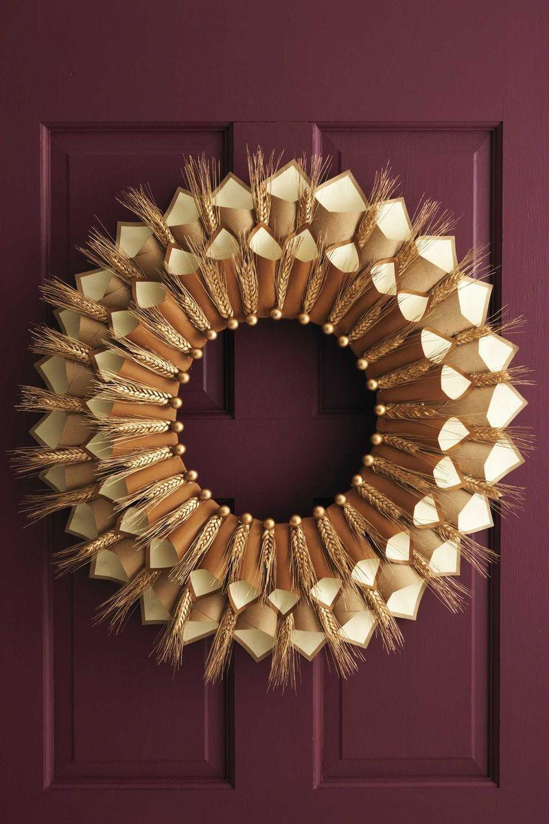 """<p>Not only is this pretty paper wreath a stunning addition to your front door, but it's also incredibly meaningful as well. Each of those cones holds a different family member's declaration of gratitude.</p><p><strong>Get the tutorial at <a href=""""https://www.womansday.com/home/crafts-projects/how-to/a5356/thanksgiving-craft-paper-cone-gratitude-wreath-112583/"""" rel=""""nofollow noopener"""" target=""""_blank"""" data-ylk=""""slk:Woman's Day"""" class=""""link rapid-noclick-resp"""">Woman's Day</a>.</strong> </p>"""
